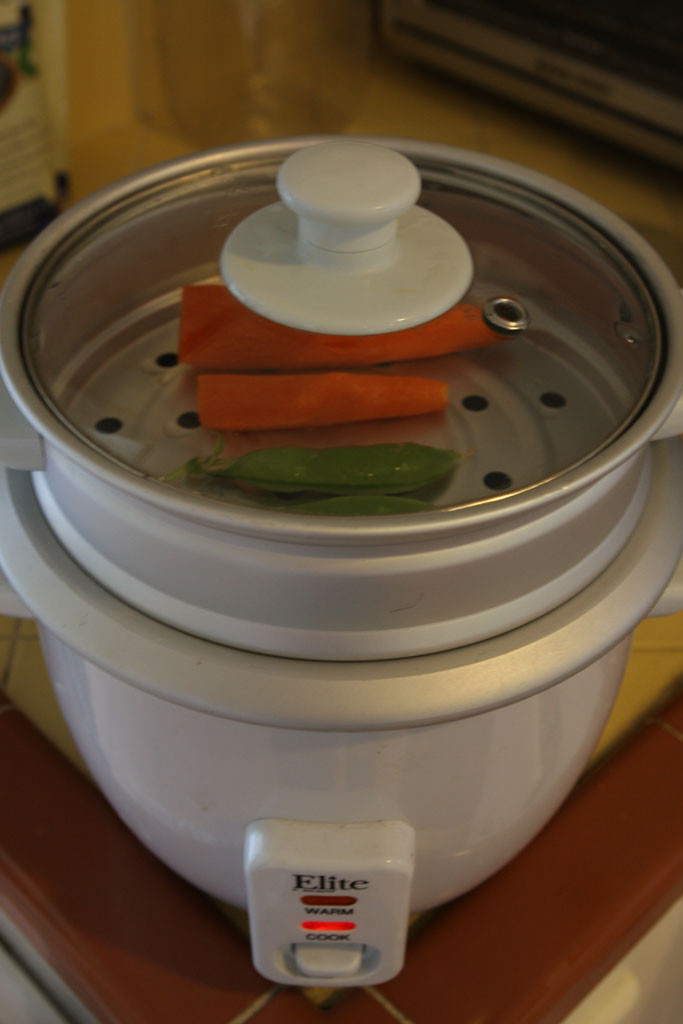 Steaming peas and carrots